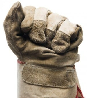 Close-up of canvas work glove on fist