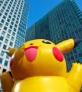 Tokyo, Japan - November 3, 2010:  Inflatable Pokemon with Skyscraper backdrop juxtaposing two disparate elements of Japanese culture