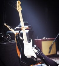Electric guitars set up on a stage