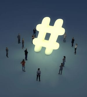 Group of people gathering around a glowing hashtag symbol