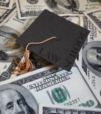 Miniature graduation cap with Law School text, on assorted cash
