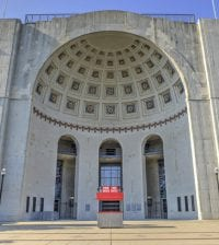 Columbus, Ohio, USA - July 31, 2016: Photograph of Ohio Stadium on the campus of The Ohio State University in Columbus, Ohio. This stadium is home of the Ohio State Buckeyes football team. It was taken in the morning with the sun facing the front of the stadium.
