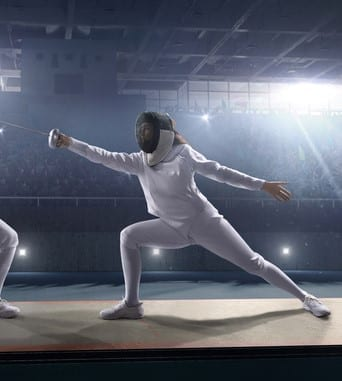 woman lunging in fencing outfit