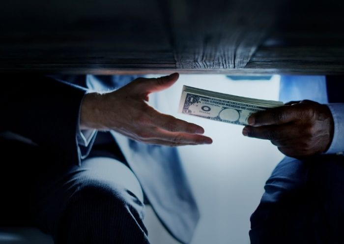 hands-passing-money-under-table-corruption-bribery-picture-id851497470