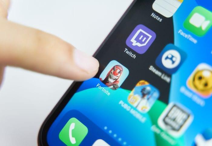 Bishkek, Kyrgyzstan - July 6 2019: Fortnite app in play smartphone. close-up on screen iphone.