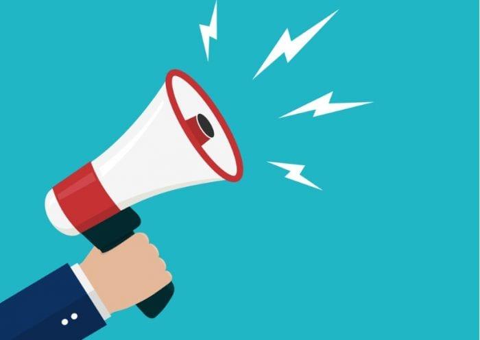cartoon-hand-holding-loudspeaker-loud-voice-horn-megaphoneflat-banner-vector-id1176219079