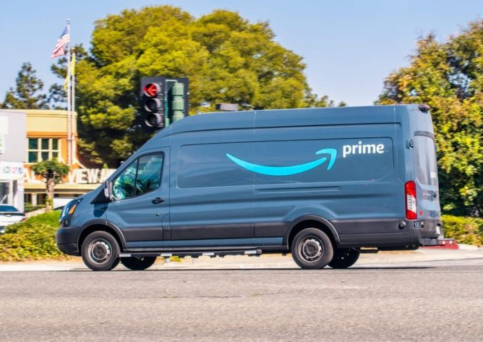 Oct 10, 2019 Mountain View / CA / USA - Amazon van branded with the Amazon Prime logo, making deliveries in San Francisco bay area