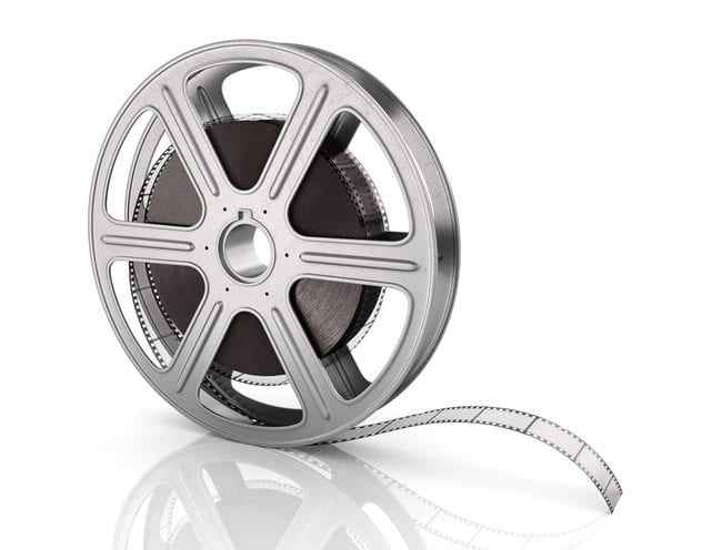 Motion picture film reel on the white background.