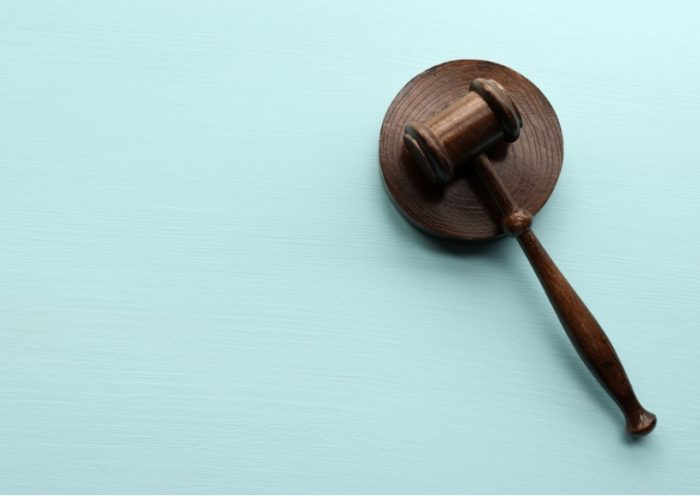 wooden-gavel-on-blue-background-picture-id1285680895