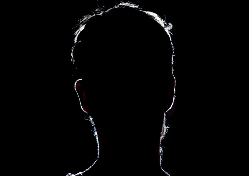 lighten-portrait-silhouette-of-a-human-head-in-the-dark-background-picture-id1028373274