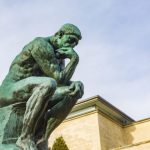 August Rodin's famous sculpture The Thinker in the grounds of the Musee Rodin, Paris