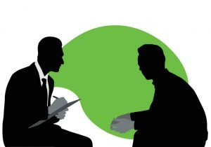 Therapist talking to his patient in this silhouette illustration